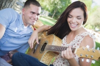 guy_listening_to_girl_playing_the_guitar